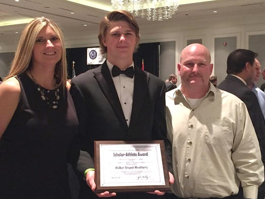 Walker Weatherly from Harpeth High School and his parents.