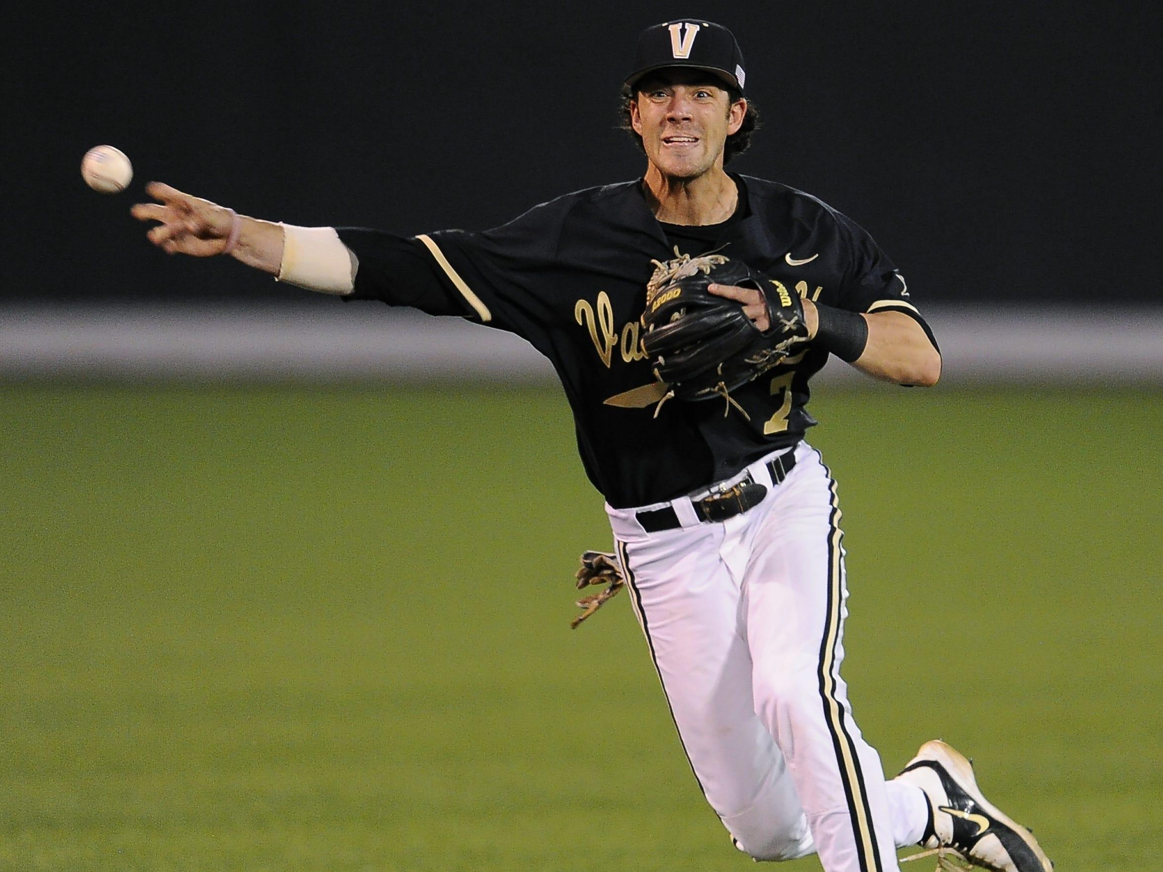 Vanderbilt short stop Dansby Swanson (7) makes a throw