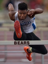 Memorial's Stacen Cunningham clears the last hurdle