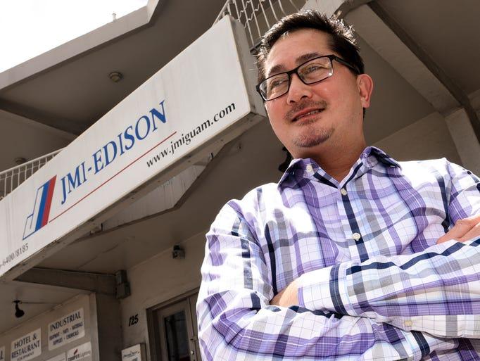 JMI-Edison Vice-President John Ilao photographed outside