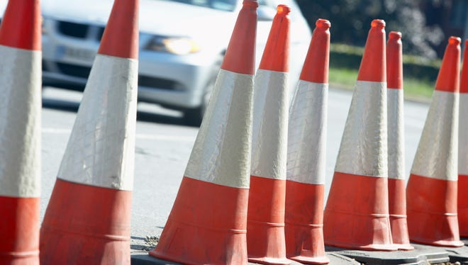 A retired engineer has questioned a city official's handling of a road project.