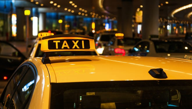 If a driver approaches you in the arrivals area of an airport, be wary. Most airports require taxis to wait in an official queue.