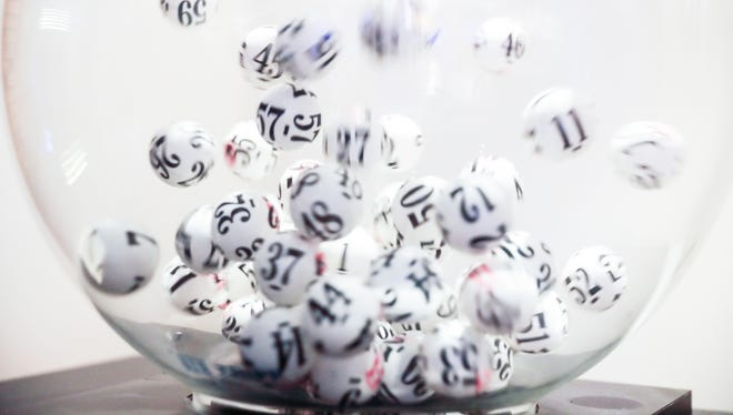 Black and white lottery balls