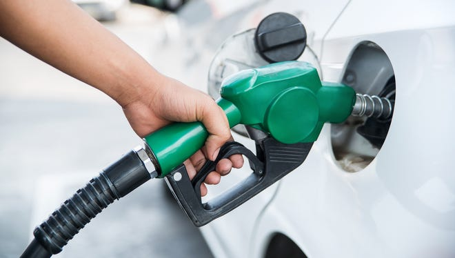 Handle fuel nozzle.
