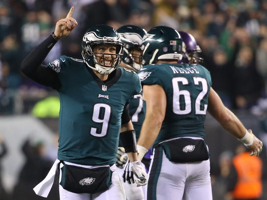 Eagles quarterback Nick Foles (9) celebrates after