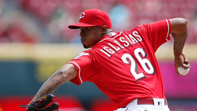 Raisel Iglesias delivers to the plate on April 20 against the Colorado Rockies.