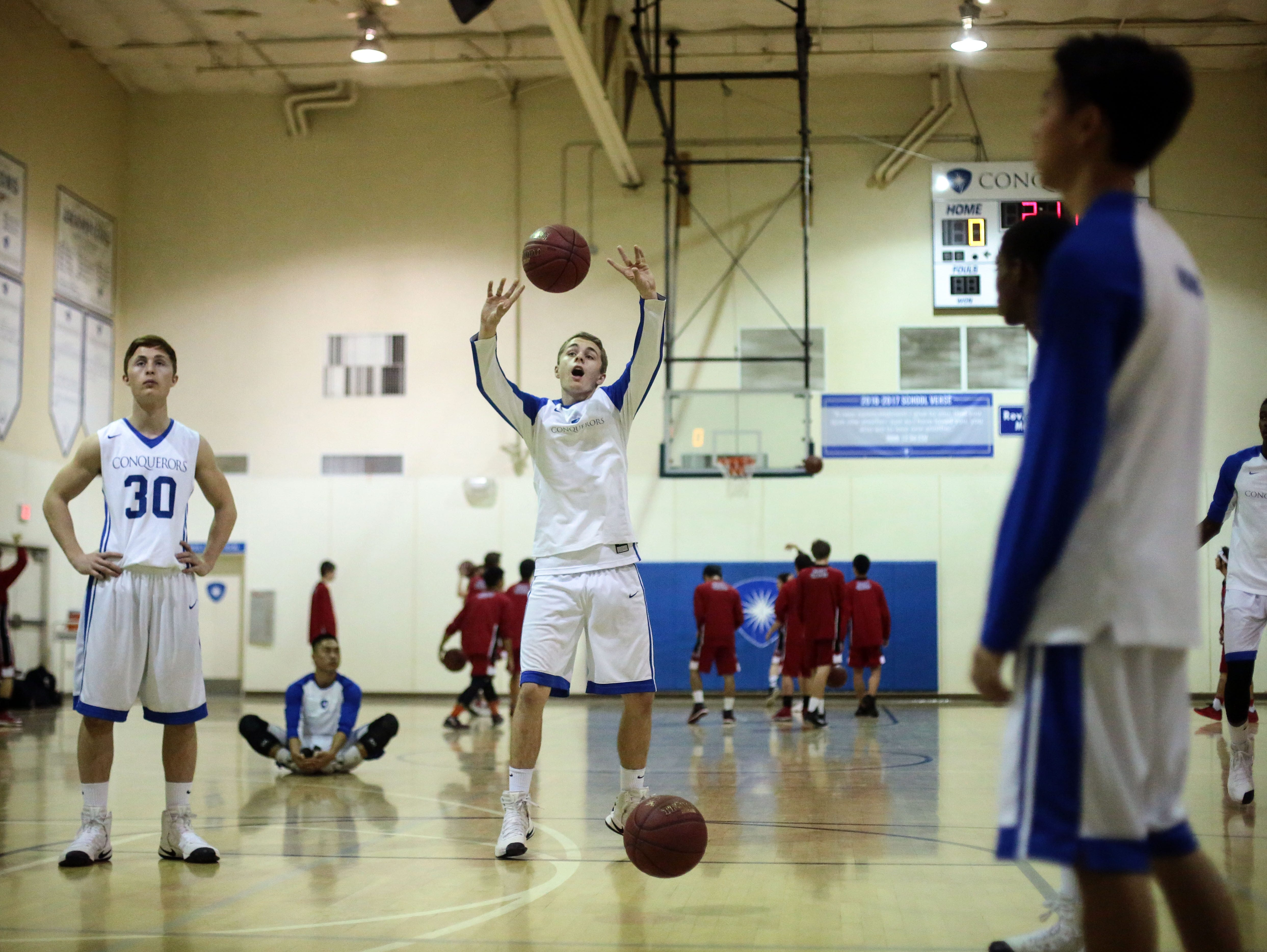 Desert Christian forward Will Whitaker shoots during warm up with his team on Wednesday, February 7, 2017 in Bermuda Dunes before their game with Palm Valley.