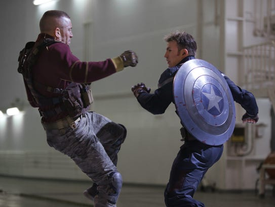 "Georges Batroc (George St-Pierre, left,) and Captain America/Steve Rogers (Chris Evans) in a scene from the motion picture ""Marvel's Captain America: The Winter Soldier."" CREDIT: Zade Rosenthal, Marvel [Via MerlinFTP Drop]"