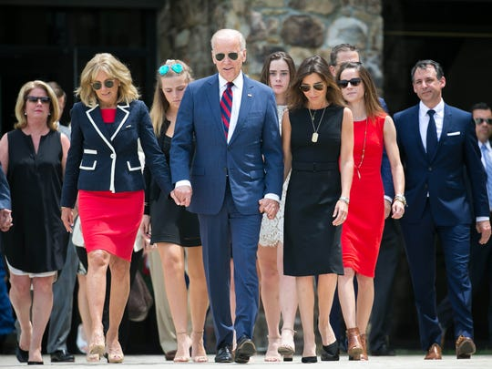 Vice President Joe Biden holds the hands of his wife Dr. Jill Biden (left) and his daughter-in-law Hallie Biden as they arrive for the dedication of his son Beau. The Delaware National Guard honor the late Beau Biden, a former Attorney General, and a Major in the Delaware Army National Guard, by naming the Delaware National Guard Headquarters, located at 250 Airport Road in New Castle, after him.