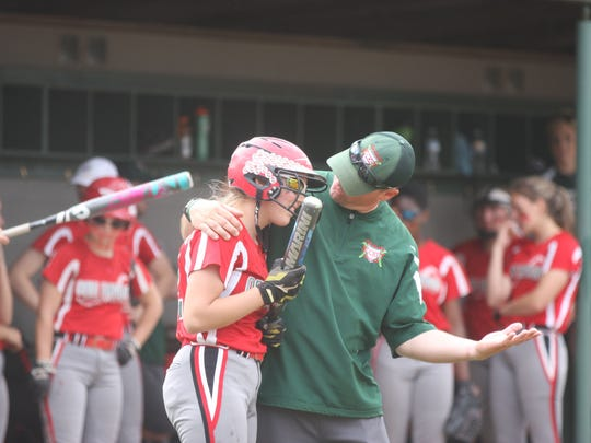 Oak Harbor coach Chris Rawski encourages Kaytlynn Sandwisch.