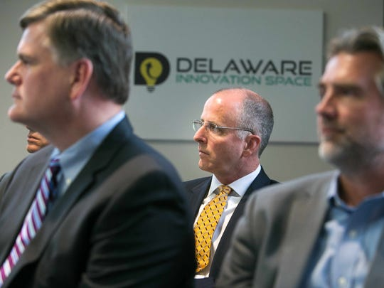State Sen. Greg Lavelle (center) joins Gov. John Carney as he signs House Bill 226 in August. The legislation restructured Delaware's economic development efforts and created the Delaware Prosperity Partnership. Lavelle is now one of 19 people on the organization's board.