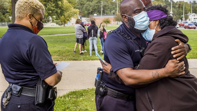 Manual Academy resource officer Charles Nathan embraces Margaret Williams, mother of Diamond Williams, during a gathering outside the school Monday, Sept. 28, 2020. Diamond Williams is one of four Manual graduates who died in a single-vehicle accident on SW Washington Street in Peoria early Sunday. School officials offered family members and student friends of the young women an opportunity to offer each other consolation. At left, is Manual resource officer Chakira Tubbs.