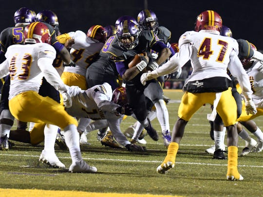 Hattiesburg High's Jarod Conner carries the ball in a playoff game against Laurel on Friday in Hattiesburg.