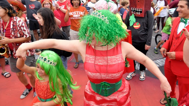 Carolyn Maragno dances with her daughter, Nora, during a parade at the 14th annual Tomato Art Fest in East Nashville on Saturday, August 12, 2017.