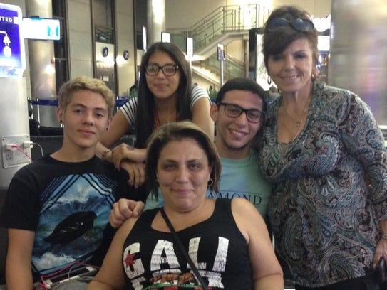 Filomena Santos (bottom, center) with family members