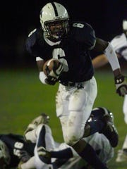 Gates Chili's Ernest Jackson during a game against PIttsford in 2004.