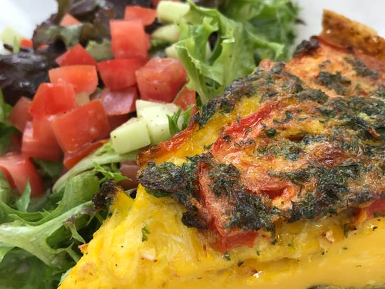 The Spanish omelet is served with salad at Buckley's