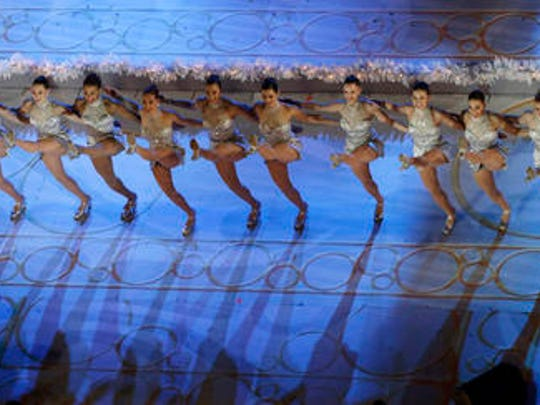 FILE - In this Wednesday, Dec. 4, 2013, file photo, the Rockettes perform before the lighting of the Rockefeller Center Christmas tree in New York. The Radio City Rockettes have been assigned to dance at President-elect Donald Trump's inauguration January 2017.