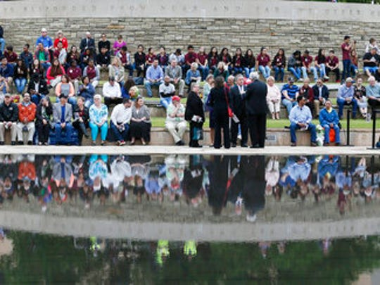 People wait for the 22nd Anniversary Remembrance Ceremony to begin at the Oklahoma City Memorial in Oklahoma City, Wednesday, April 19, 2017. Survivors and family members of those killed in the Oklahoma City bombing will gather for a remembrance service Wednesday, the 22nd anniversary of the attack. Carson is speaking at the 22nd Anniversary Remembrance Ceremony.