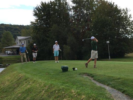 Spackenkill High School's Erik Stauderman tees off
