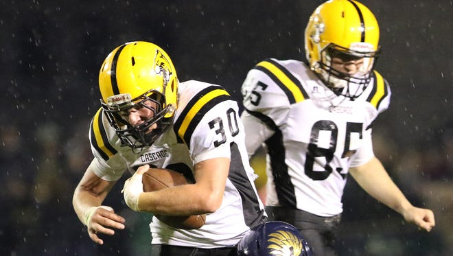 Cascade's Garrett Coffey runs the ball as the Cougars defeat Stayton 31-7 in an Oregon West Conference game Friday, Oct. 16, 2015.