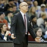 UC coach Mick Cronin is in Las Vegas to discuss the UNLV job, according to a report.