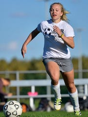 Sauk Rapids-Rice High School freshman forward Chloe Stockinger races forward with the ball during a drill in practice Wednesday at the school.