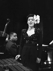 Billie Holiday's soaring talent and sad personal life are the stuff of legend.ca. 1930s-1950s --- Singer Billie Holiday performs with a jazz band, standing beside a xylophone.