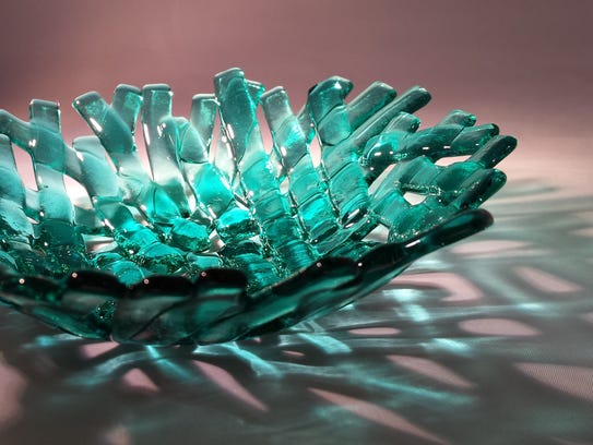 RoseAnna Stokes creates fused-glass jewelry and display