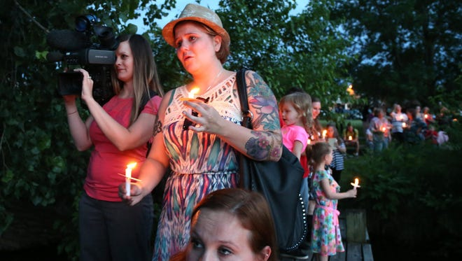 Friends, family and community members gathered together for a candlelight vigil to show their support for Melissa Zeimet, who lost her 9-month-old son, Logan Habibovic, when his father, Elvis Habibovic, took both their lives at a Missouri park.
