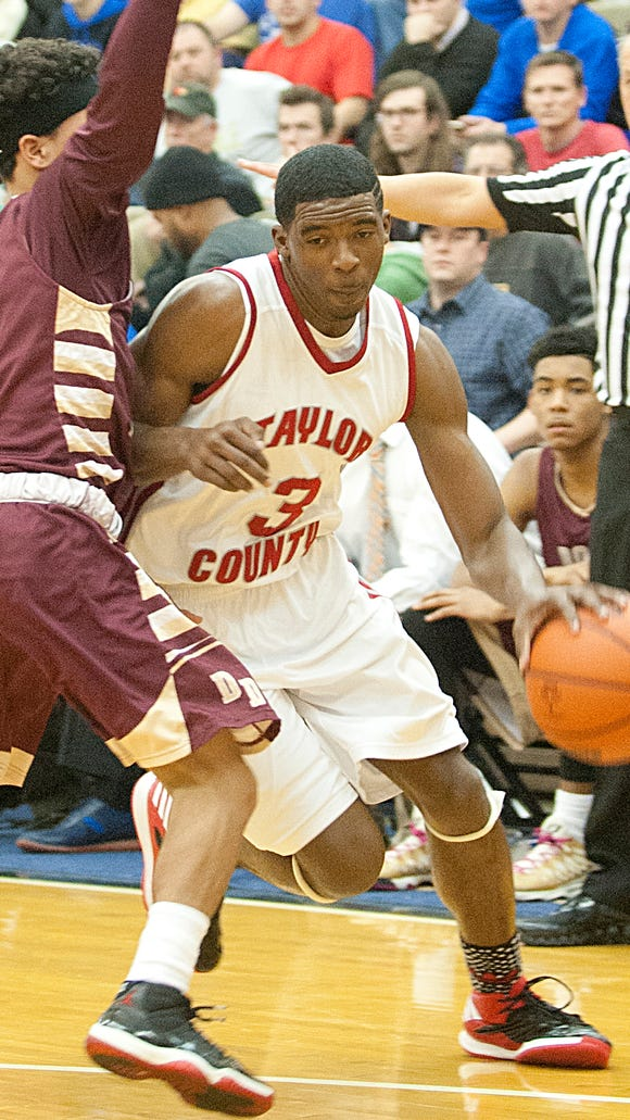 Taylor County Cardinals guard Quentin Goodin  tries to come around Doss Dragons guard William Brown.