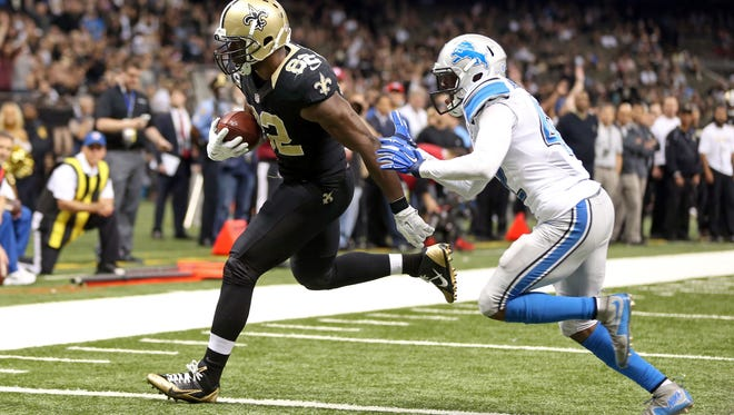New Orleans Saints tight end Benjamin Watson (82) scores a touchdown on a one-yard catch while defended by Detroit Lions strong safety Isa Abdul-Quddus (42) in the fourth quarter of the game at the Mercedes-Benz Superdome.
