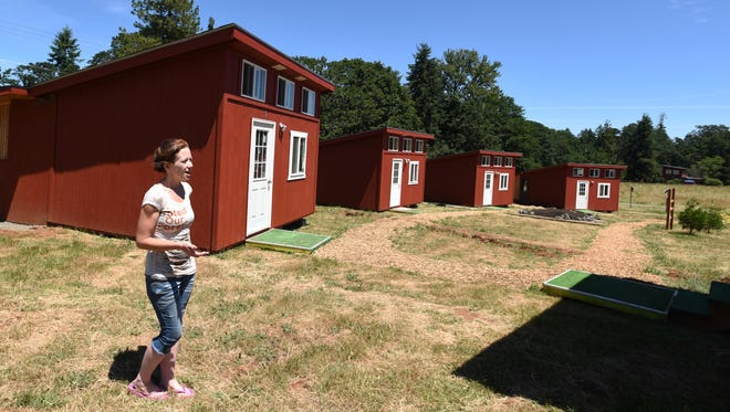 Jessica Gill, Turtle Ridge Wildlife Center Manager, talks about the center's expansion during an interview on Wednesday, June 17, 2015, in South Salem. A weeklong open house is planned for June 22-28. Visitors can tour the facility and watch volunteer staff feed baby animals.