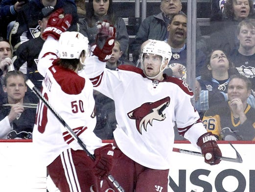 Phoenix Coyotes center Antoine Vermette (50) and left wing Mikkel Boedker (right) celebrate a goal by Boedker against the Pittsburgh Penguins during the second period at the CONSOL Energy Center on March 25, 2014.