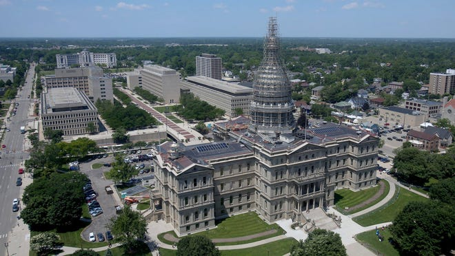 The dome of Michigan's Capitol in Lansing is undergoing extensive renovations, from new stonework to sandblasting and fresh coats of paint. It took five weeks to erect the scaffolding alone.