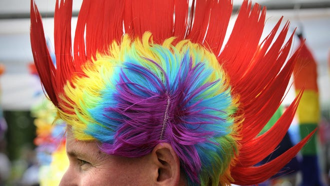 Mike Weber displays a bright, rainbow-colored head at Pride in the Park.