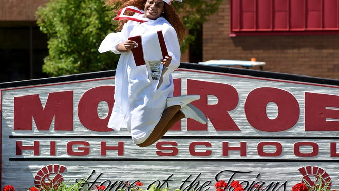 Cortenasia McCray, 18, leaps after she was filmed for Monroe High School's virtual graduation ceremony. The production will be shown Sunday at 8:45 p.m. on two large screens at the high school.