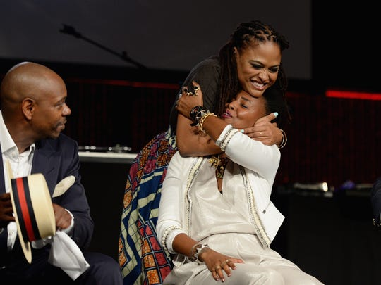 Dave Chappelle, Eva DuVernay and Wangechi Mutu attends as Russell Simmons' Rush Philanthropic Arts Foundation Celebrates 20th Anniversary At Annual Art For Life Benefit at Fairview Farms on July 18, 2015 in Water Mill, New York.