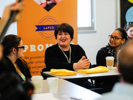 Annemarie Resweber, center, speaks about her experiences as the mother of a student in the Louisiana Virtual Charter Academy at a Wednesday roundtable at Willow Charter Academy.