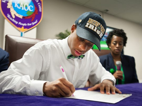 Greer High School's Troy Pride Jr. signs with Notre Dame football during a signing ceremony at Kingdom Assembly Outreach Center in Greer on Wednesday, February 3, 2016.