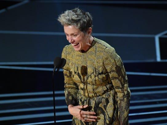 Frances McDormand accepts the Oscar.