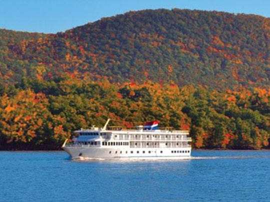 The Hudson River Fall Foliage Day Cruise is on a catamaran featuring an open-air top deck or climate-controlled cabins with 360-degree panoramic windows.