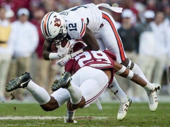 Alabama defensive back Minkah Fitzpatrick (29) stops