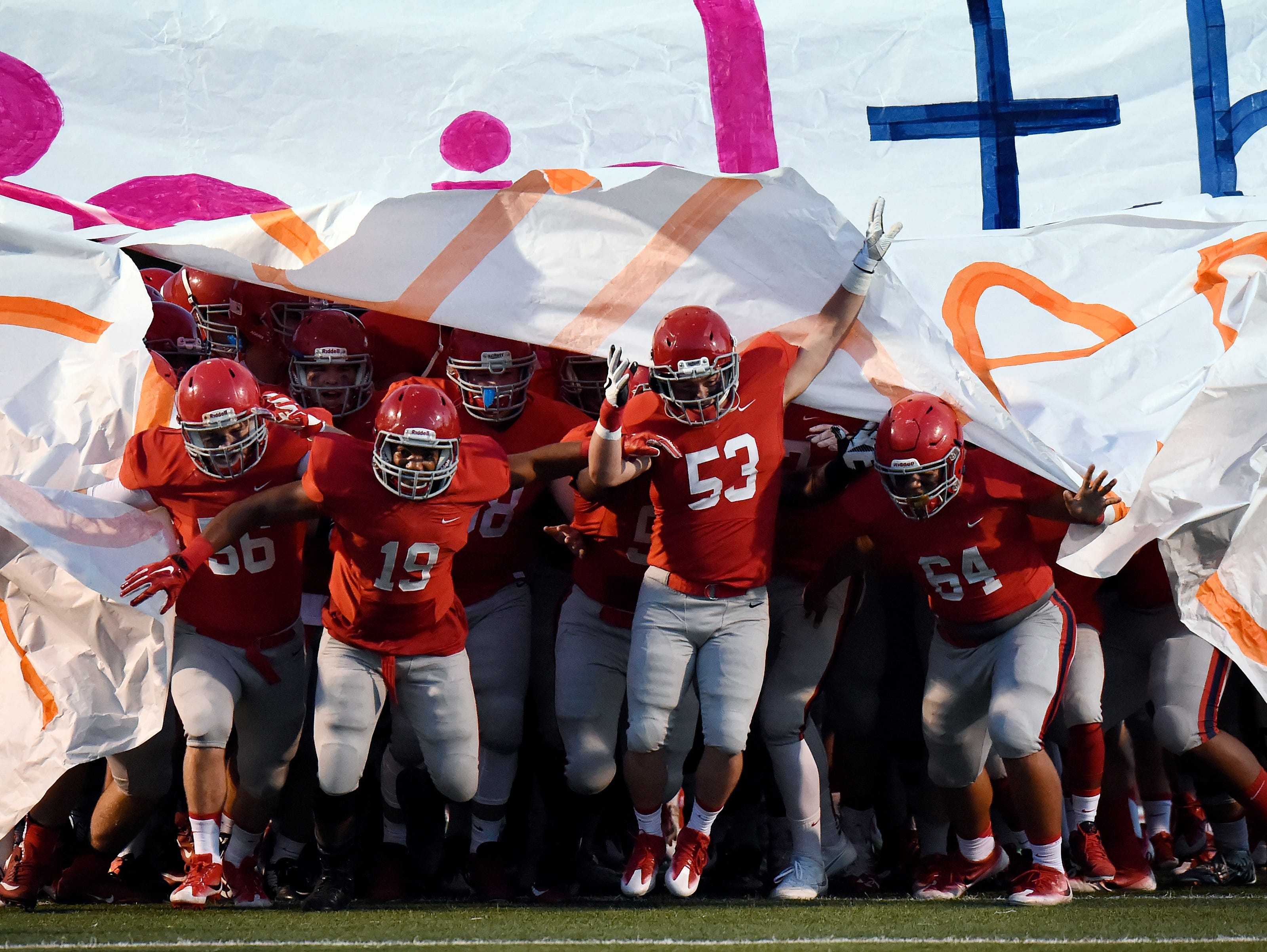 Brentwood Academy football players run onto the field before an high school football game against Baylor on Friday, Sept. 16, 2016, in Brentwood, Tenn.