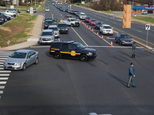 Delaware State Police redirect traffic on Kirkwood Highway as police investigate the scene Tuesday afternoon.