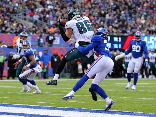 Dec 17, 2017; East Rutherford, NJ, USA; Philadelphia Eagles tight end Zach Ertz (86) catches a touchdown pass against New York Giants safety Andrew Adams (33) during the second quarter at MetLife Stadium. Mandatory Credit: Brad Penner-USA TODAY Sports