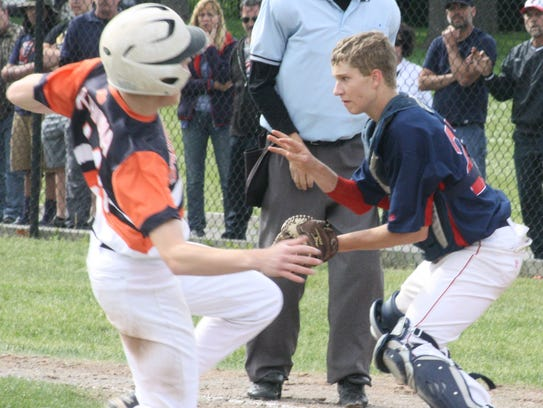Franklin catcher Kyle Wollam waits for a throw to plate