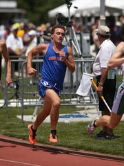 Zane Trace's Cole Clever runs the 1,600 during the