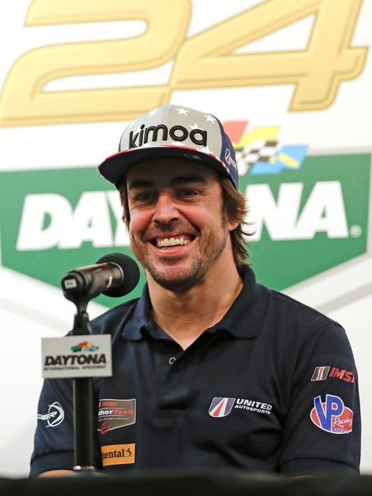 Fernando Alonso, of Spain, answers questions at a news conference about the IMSA 24-hour auto race at Daytona International Speedway, Thursday, Jan. 25, 2018, in Daytona Beach, Fla. (AP Photo/John Raoux)