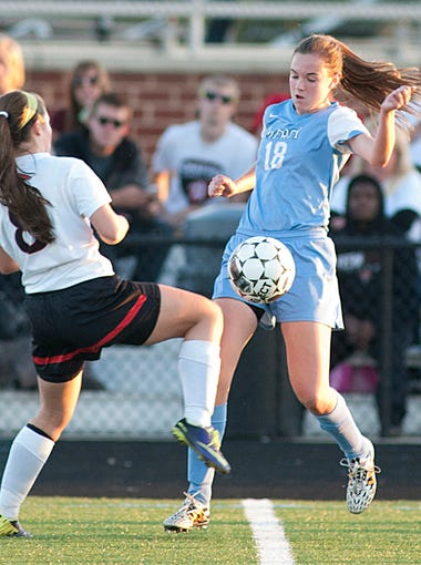Bullitt East Lady Chargers' Kelsey Castle and Mercy